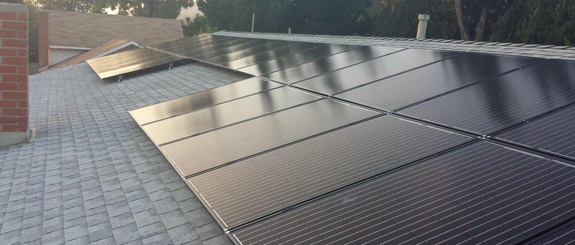 Rooftop view of solar panels installed on top of a home.