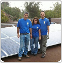 Electricians on roof after solar panel installation