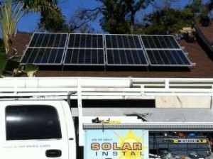 View of installed solar panels on roof and Moonlight Electric Services, Inc. truck in front.