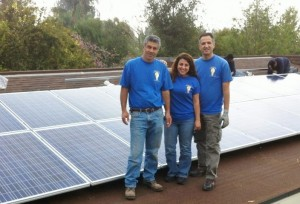 Moonlight Electric Services, Inc. crew on roof standing by newly installed solar panels.
