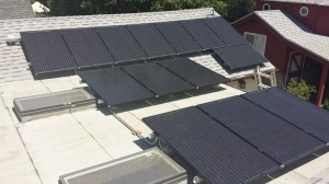 Solar panels installed on roof adjacent to sky light windows.