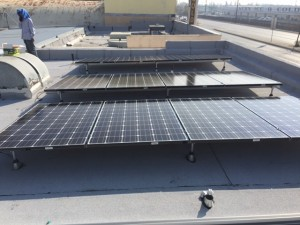 Solar panels installed on the roof of a commercial building.